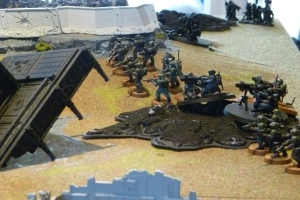 Guard weapon teams set up in the cover of a crater.